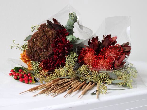 Gather the Right Materials Many specialty groceries often carry seasonal bouquets; these (from Trader Joe's) include deep reds, russets and greens. A few cattails will add extra character, and can be ordered online (these came from Crate and Barrel).