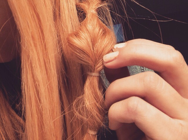 Once you are finished, make the braid appear thicker by gently tugging on the outsides.