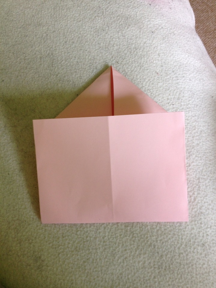 Now fold the paper/card in half up to where the triangle starts