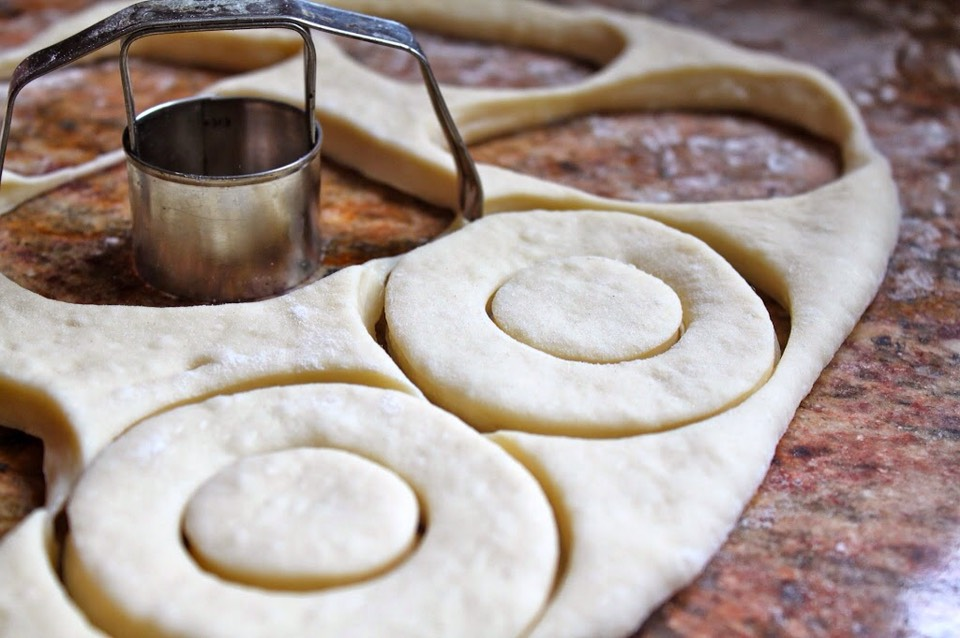 5.With a rolling pin, roll out half of the dough to about 1/2″ thickness.  Cut with a round, sharp cookie cutter (about 3″ diameter) then make the holes with a smaller cookie cutter (about 1″ diameter), saving the holes.