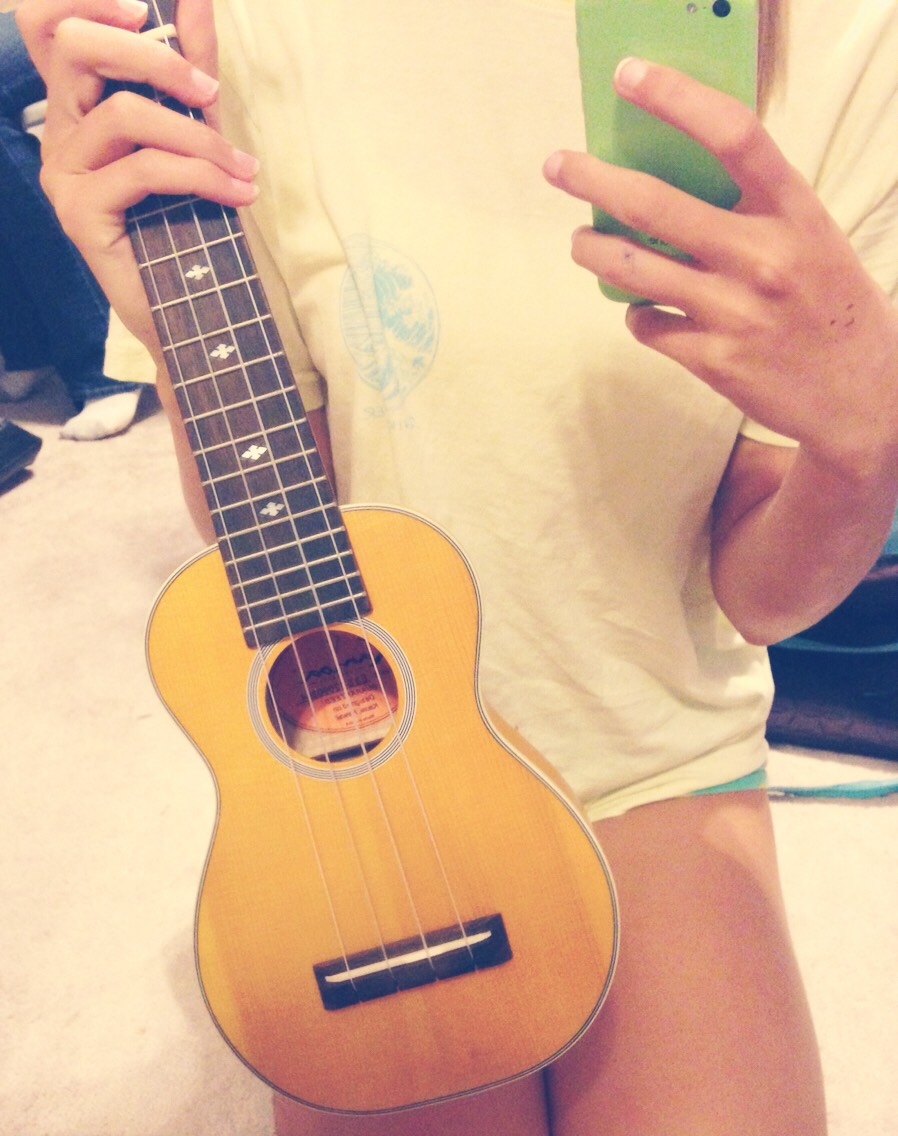 This is my uke^ it's a soprano, classically shaped, straight from Hawaii (lit) mahoa in yellow