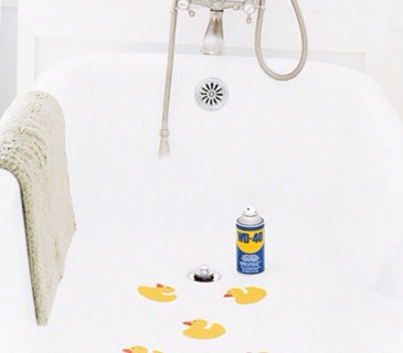 Hard-to-Remove Decals Spray the decals and the surrounding areas with WD-40, lifting the edges to get underneath, if possible. Let sit, then gently scrape away the decal with the edge of a credit card. Degrease the tub with liquid dishwashing soap.
