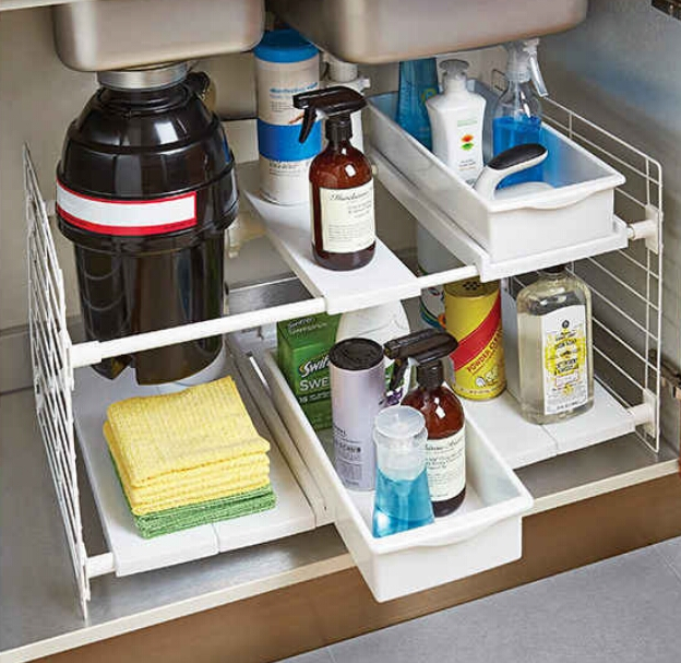 Organizer for the mess under your sink. ($39.99)  http://www.containerstore.com/s/expandable-undersink-organizer/d?productId=10035752&q=Expandable%20undersink