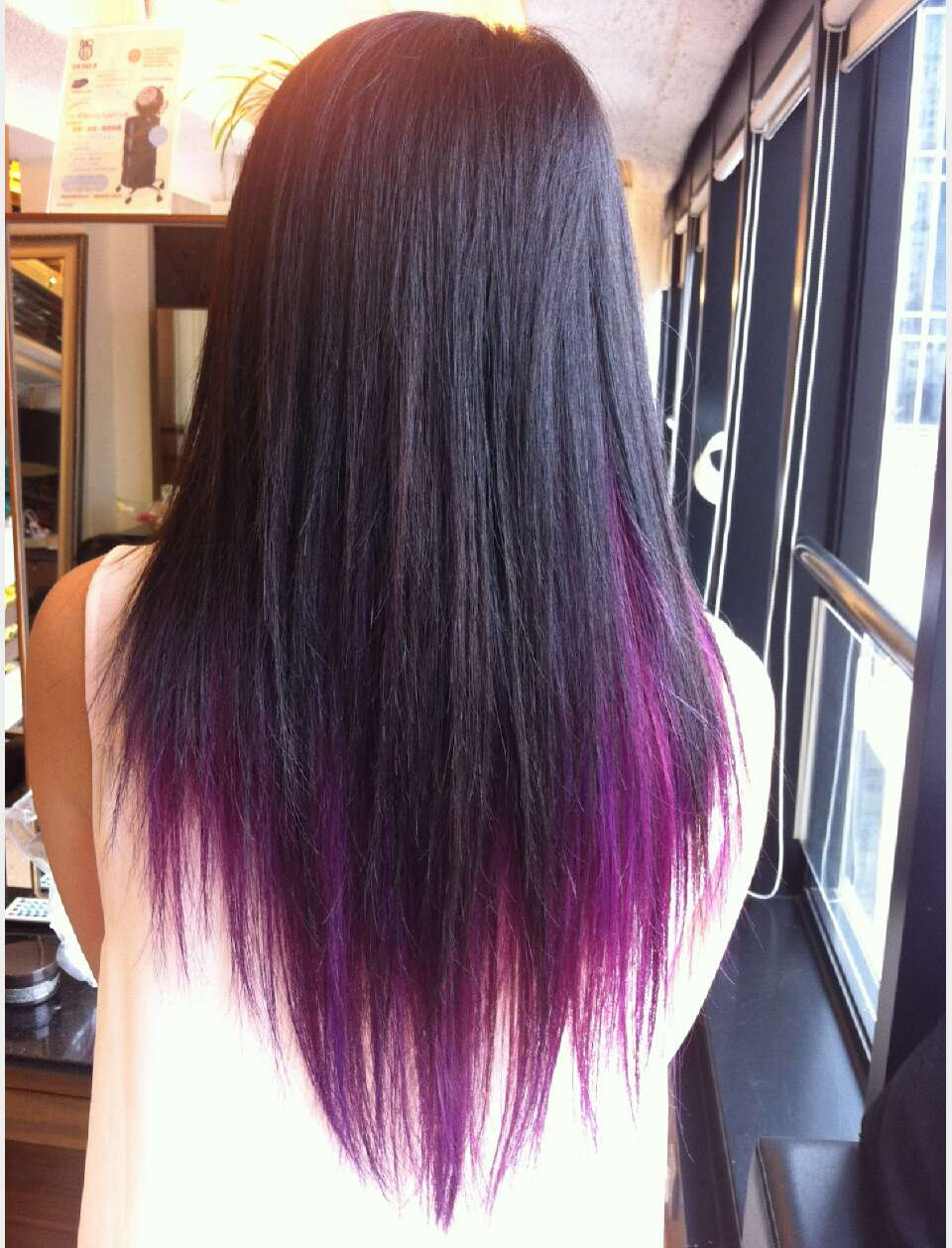 black with purple underneath