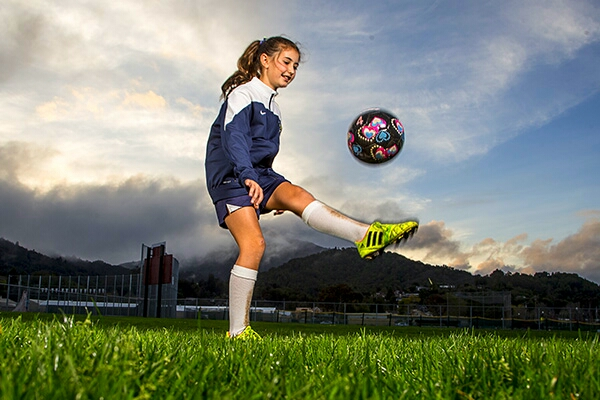First you want to kick the ball up in between your knee and waist to start then let the ball bounce off the ground until it come back up again then kick it again between waist and knee height.