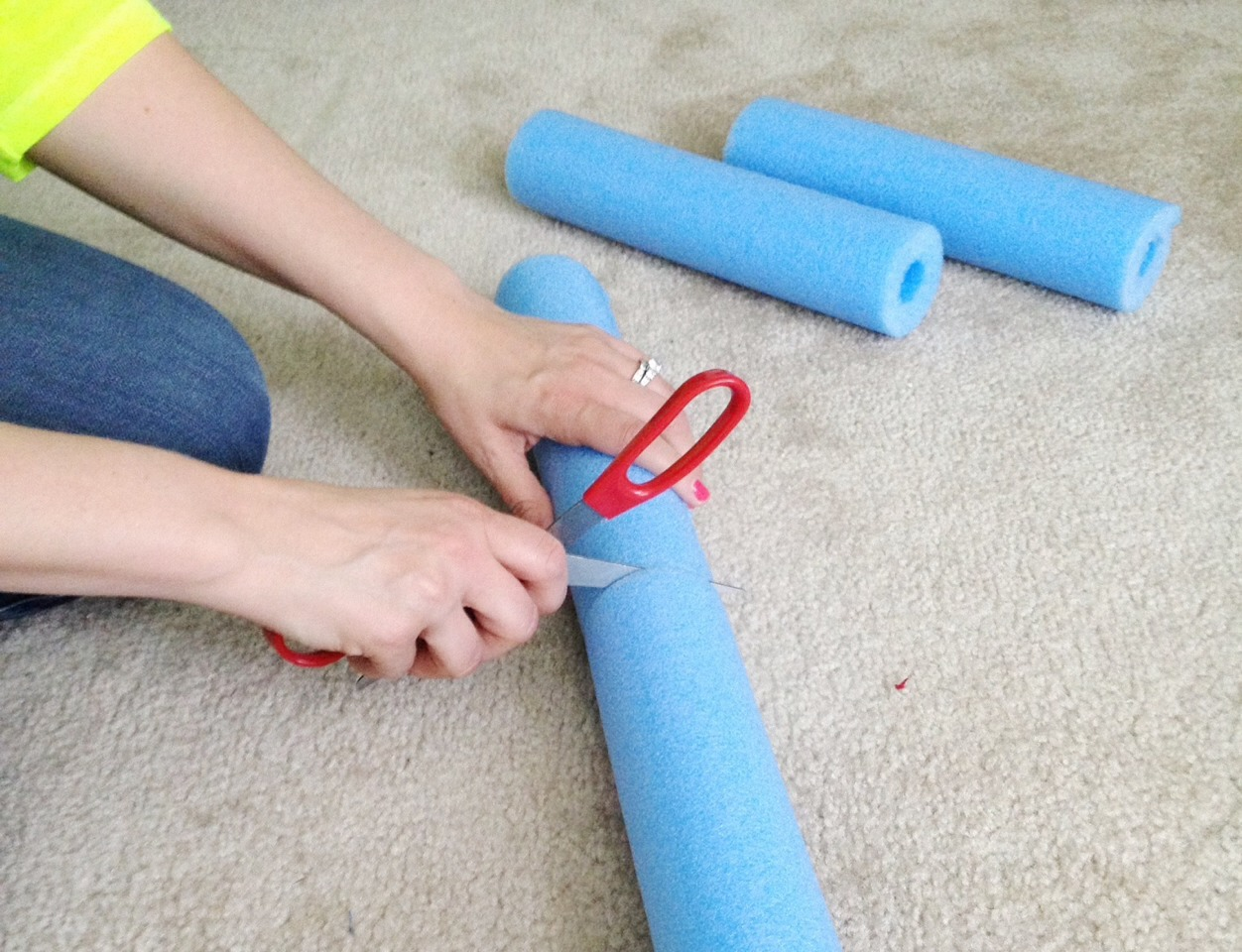 Step two: Cut the pool noodles in half.