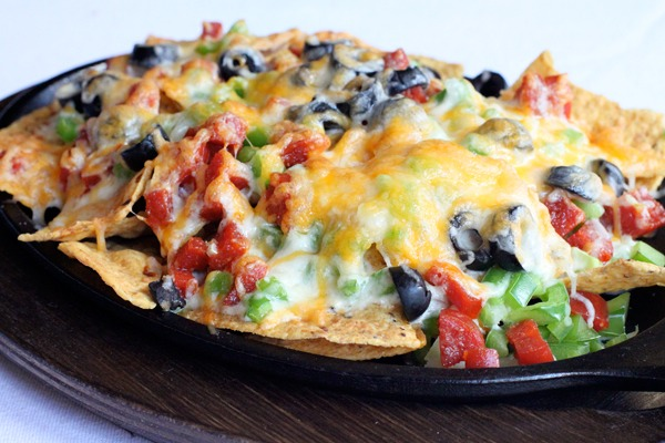 Let me just put this out there. I could probably live off of nachos and pizza, so I got the best out of these pizza nachos. You get the comfort of nachos, with any of your favorite pizza toppings. Check out my recipe.