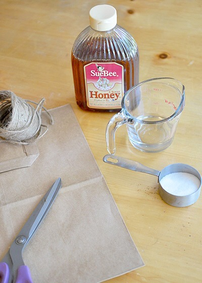 DIY FLY PAPER  What you need:  A paper grocery bag Scissors A single hole punch Twine 1/4 cup sugar 1/4 cup honey or corn syrup 2 Tablespoons water
