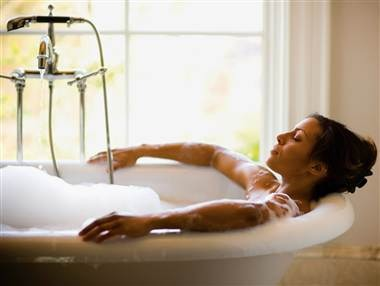 Take a hot bath. 😊 Immersing yourself in warm water will increase your circulation and relax your muscles. This will help reduce the amount of pain you are feeling in your stomach. Relax in a bath for 15-20 minutes at least once a day for the best results.