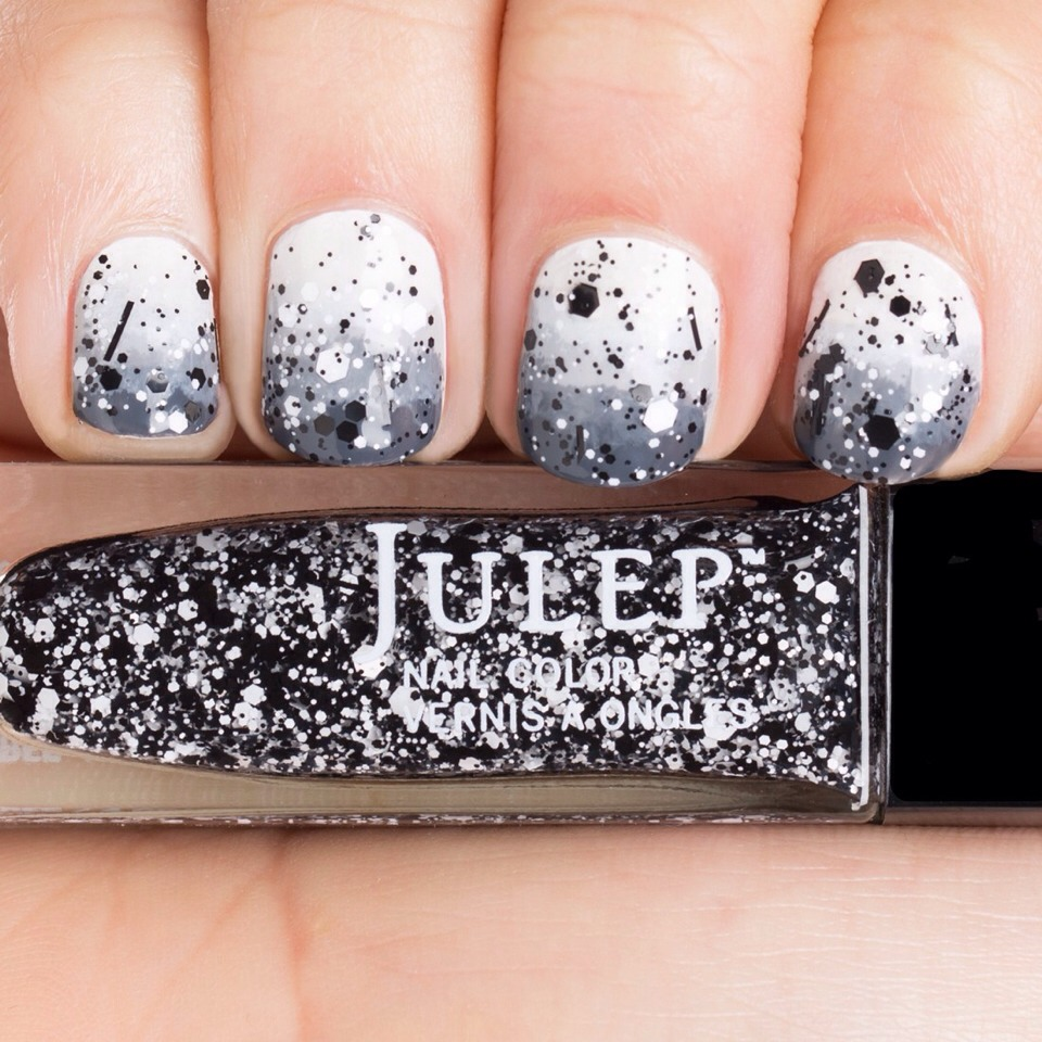 This second step will need this Julep color called 'Max' because it's a pretty original confetti style top polish. It's a combo of white and black flakes that work great on a base coat. Paint your nails 2/3 of the nail on top with this bad boy while focusing more densely towards the cuticle.
