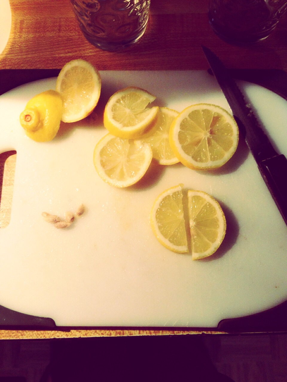 Cut the Leominster in little sections and take out the seeds  Take one lemon and cut it in half