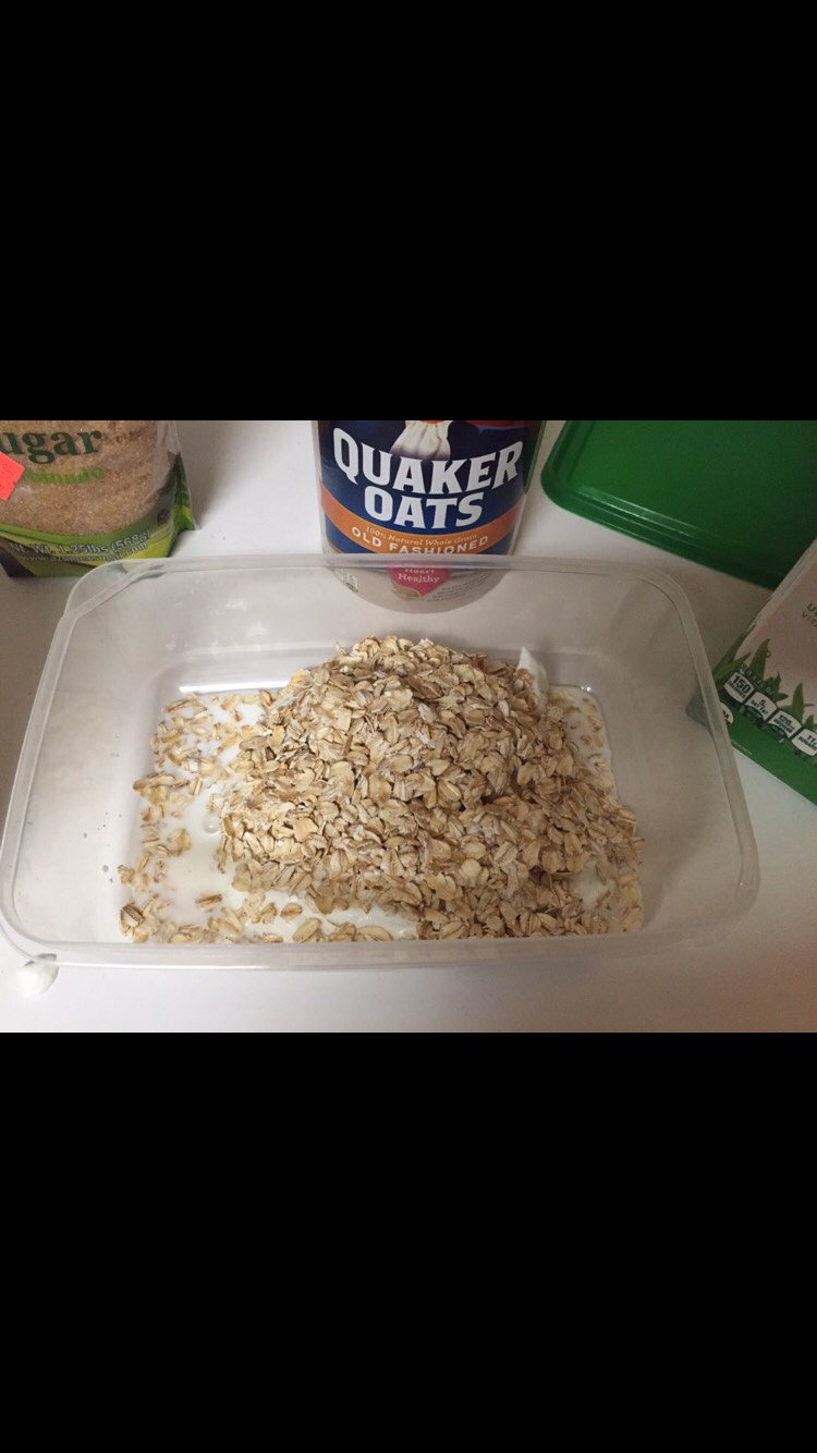 Add two handfuls of oats and a small drizzle of milk.