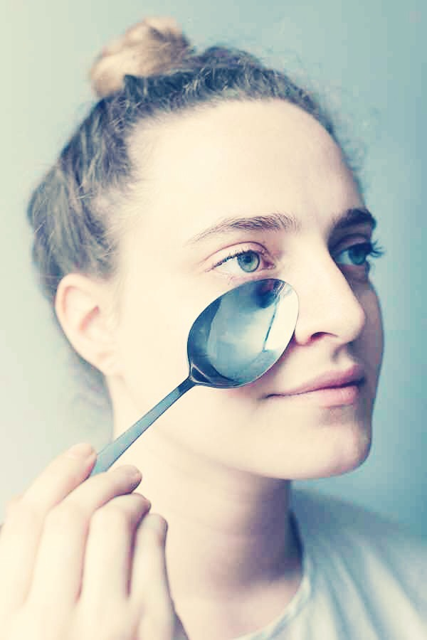 Running a metal spoon under cold water for a couple minutes and then putting it on the skin around your eye can help reduce dark circles.