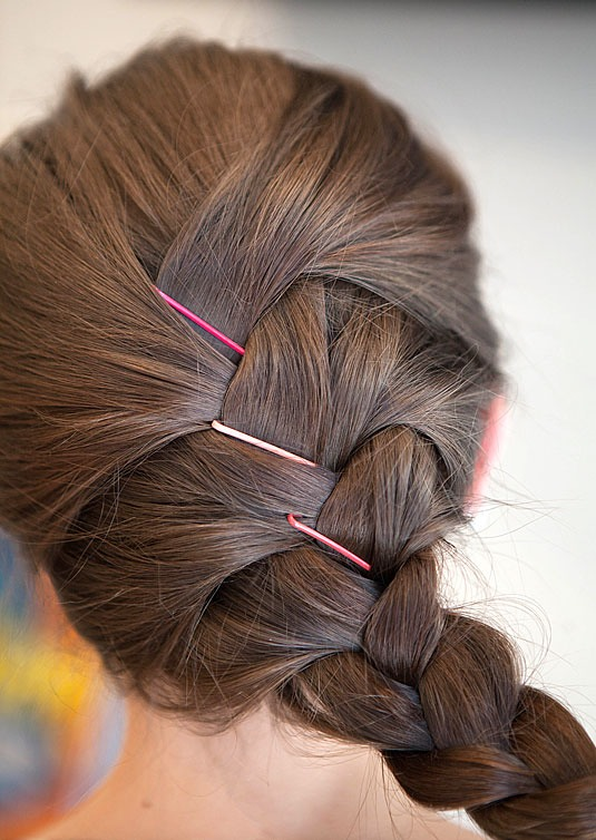13. Fix any wispy pieces or bumps with cute bobby pins instead of redoing your entire updo. If your hair has a lot of shorter layers that stick out of your braid, tuck them in with pretty pins.