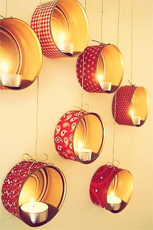Wow! If you don't find this amazing and quirky, there's something wrong with you!   This involves using old and recycled tin cans (washed very carefully). Placing ribbon around the outside, preferably with hot glue so it stays in place. Sticking them to your wall, in whatever pattern you chose!