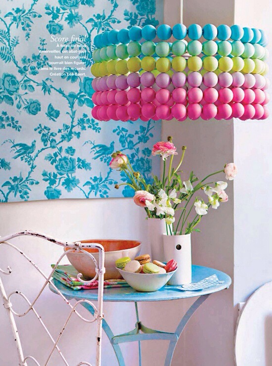 Make a beautiful hanging chandelier with ping pong balls. Paint for bright colors.