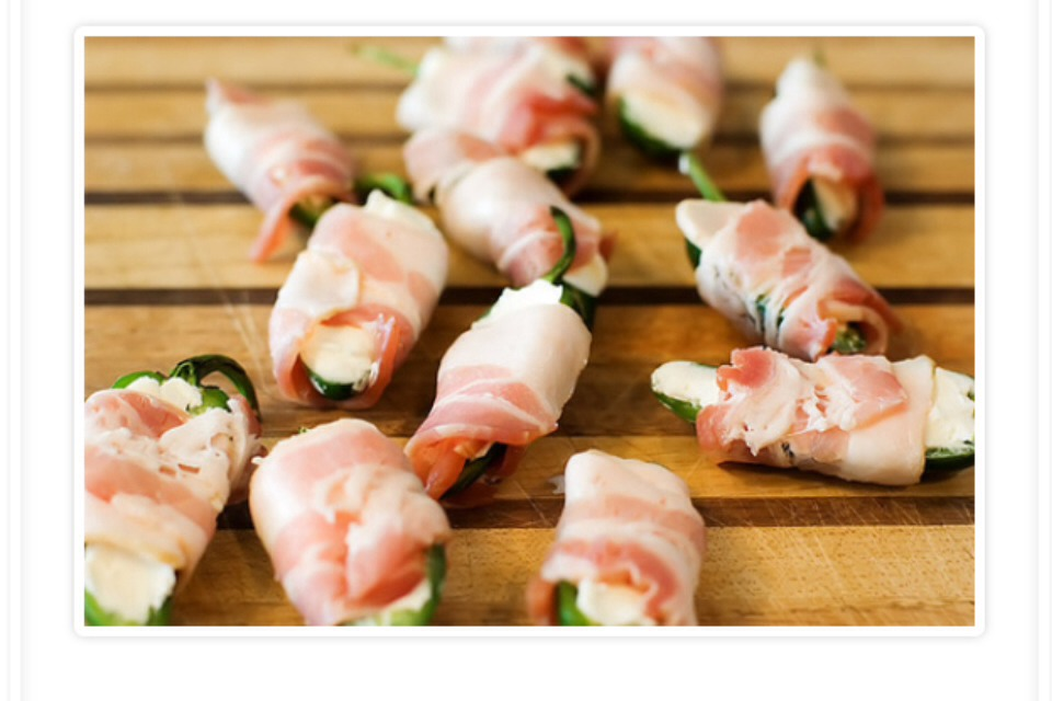 Then take and cut your bacon slices in half and wrap a piece around one of the jalapeños no to tightly !