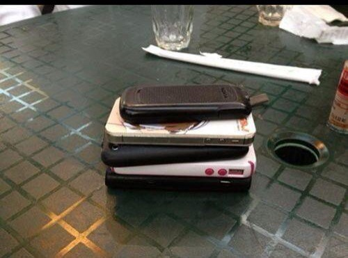 Game: Stack phones in the middle of the table and the first to check their phone has to pay the bill :-)