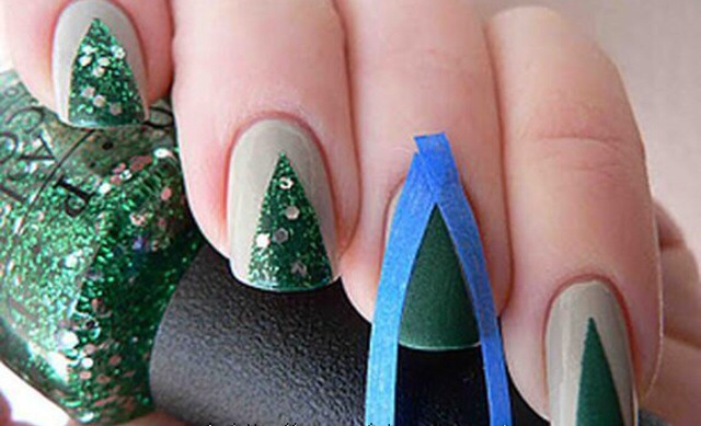 If you love all things green, these Christmas tree nails are a no-brainer! They look great and they're super easy to do. You simply cut little strips of tape and paint them in.