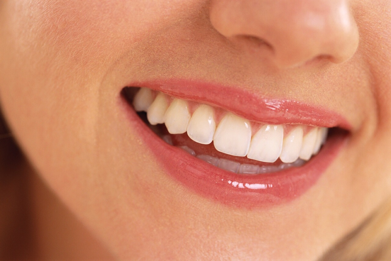 Smile :D it looks good on you and is a warm inviting look.
