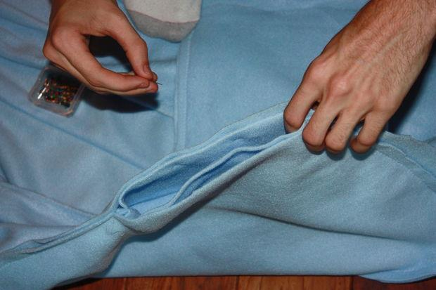 If you remember, you should have an opening. Tuck the sleeves into the hole with the right side in. This way, after you sew it and flip it inside out, it will have the wrong side out which is what you want.