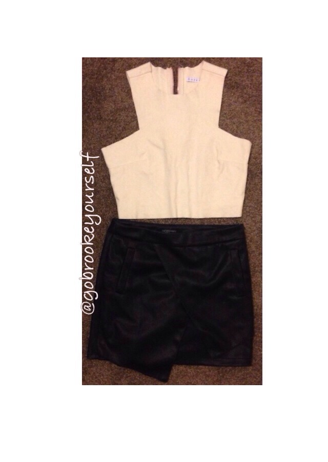 Creme top with black leather skirt! Really cool! Wear your hair up in a slick ponytail and have your eyeliner thick!