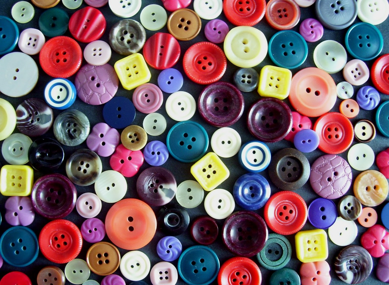 Place a toothpick between the button and the fabric while sewing. This will create a bit of space so the button won't attach too tight, becoming tough to fasten!