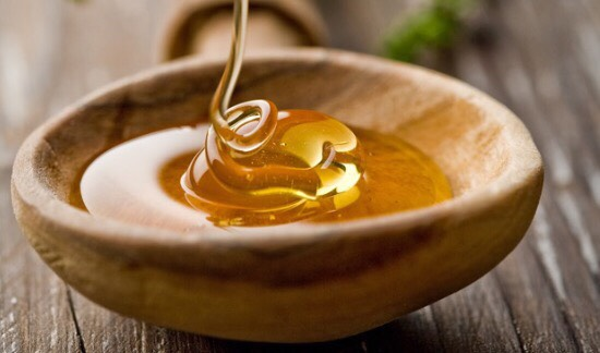 First take ONE  spoonful of honey and put in a small cup,container,bowl etc.