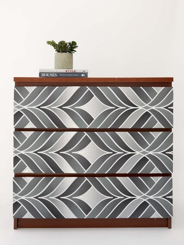 In a Day: Wallpaper Your Dresser Stylish wallpapers are making a huge comeback. Not ready for all that paste? Install a wallpaper you covet atop a basic modern dresser for a not-so-permanent dose of pattern.