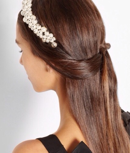 4. When it comes to jewelry, pearls are classic. Which makes this Maison Michel Astrid faux pearl headband hard to resist. It's a gorgeous winter hair accessory that can absolutely be considered seasonless.