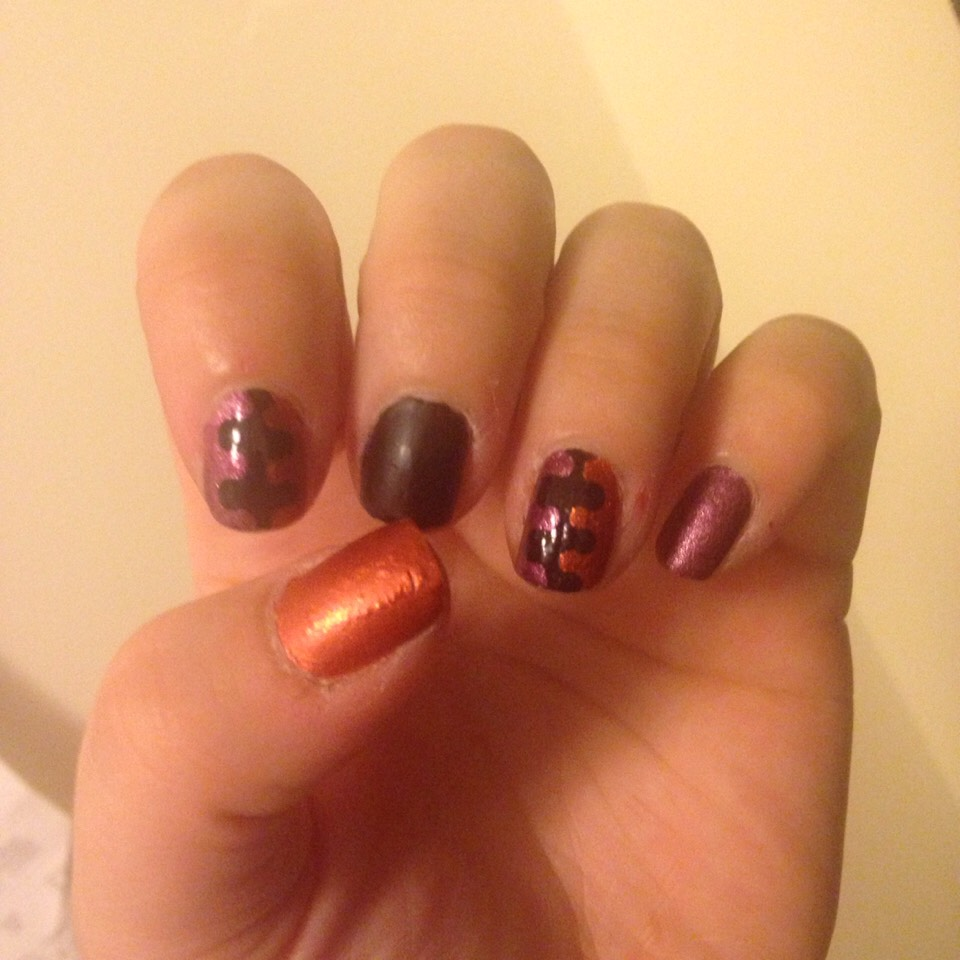 "Orange , purple and black nails with ""interlocking"" accent nails"