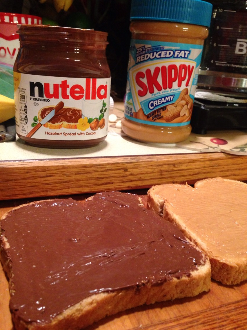 Start by spreading Nutella on one piece of bread and peanut butter on the other