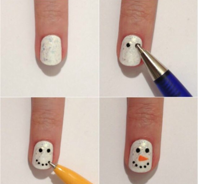 Snowmen are an easy nail design to create. Simply paint the nails white and add little black dots for the eyes and an orange triangle for the nose using a dotting tool (or even a pen or toothpick)