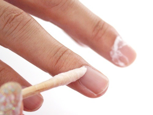 Wipe the cuticle remover with paper towel or cotton pad, then gently push back the cuticle in small circular motion. Change the cotton on the orangewood stick if it becomes too damp.