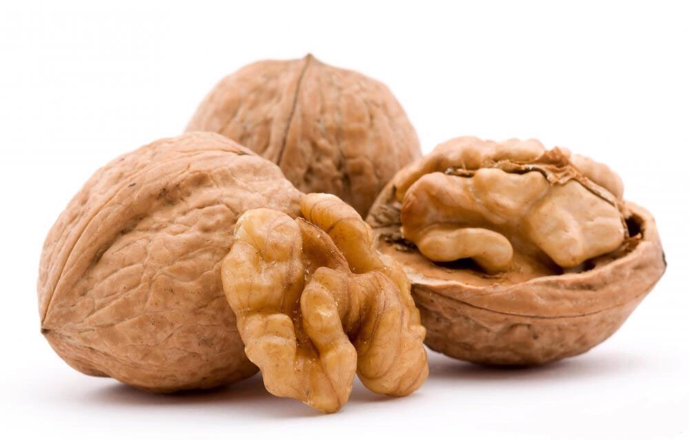 Walnuts: Have a significant amount of omega-3 fatty acids. They're also rich in biotin and vitamin E, which helps protect your cells from DNA damage. Too little biotin can lead to hair loss. Walnuts also have copper, a mineral that helps keep your natural hair color rich and lustrous.