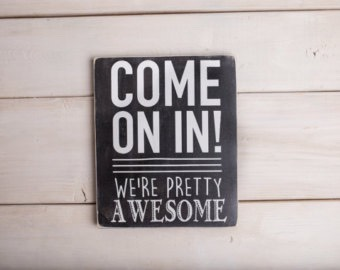 Welcome Signs Create your very own welcome sign with a little bit of chalkboard paint and a wood trivet. Drill a hole through the trivet and hang it on your front door with a bit of craft twine.