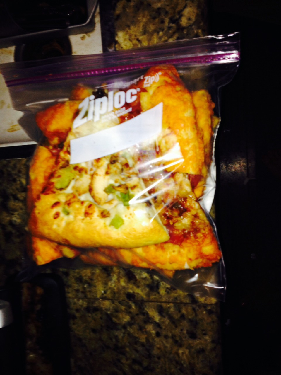 Ziplock the tower in a freezer size bag and write the date on it. Good way to save space and determine whether you should reheat that old pizza or throw it out!
