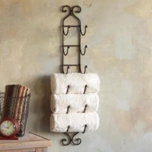 Hanging wine rack to store your towels/hand towels.