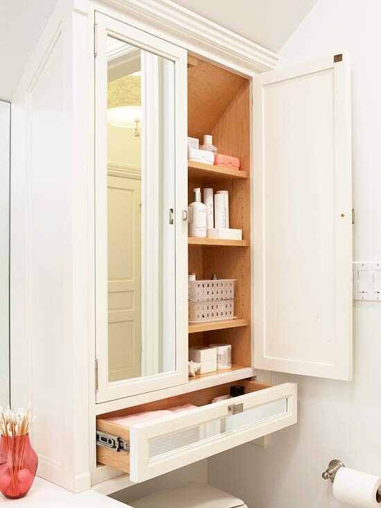 Combine Cabinet Types Not all storage works the same: Doors and drawers each serve a purpose to stash different types of items, especially in heavy-traffic areas such as bathrooms. Even in tight spots, mix up the options -- here, a narrow drawer steals a few precious inches above the toilet.
