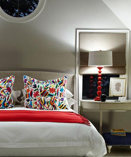 In the Red When decorating with a stimulating shade in the bedroom, the key is to tone it down by pairing it with a classic white.