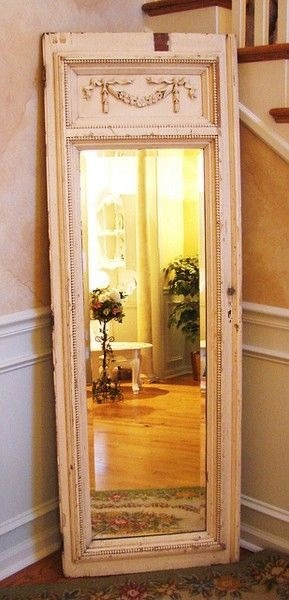 Take an old door and hot glue a mirror to it