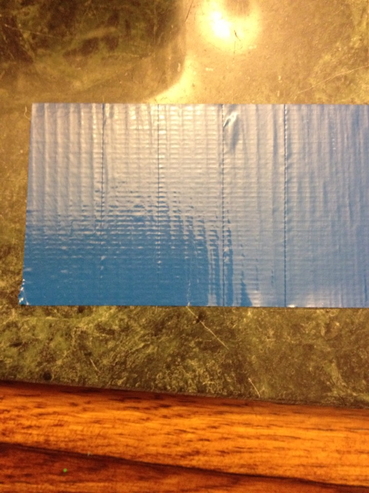5. Cut thick pieces of the blue to cover the white on the corners of the jar