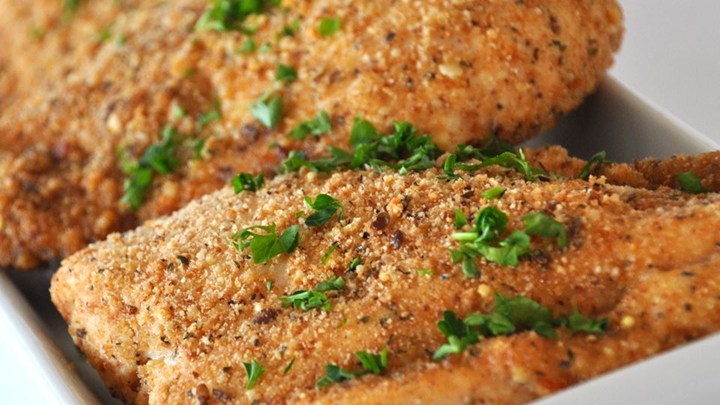 Ingredients:  *2 tbsp olive oil *1 garlic clove, minced *1 cup dry bread crumbs *2/3 cup grated Parmesan cheese *1 tsp dried basil leaves *1/4 tsp ground black pepper *6 skinless, boneless chicken breast halves