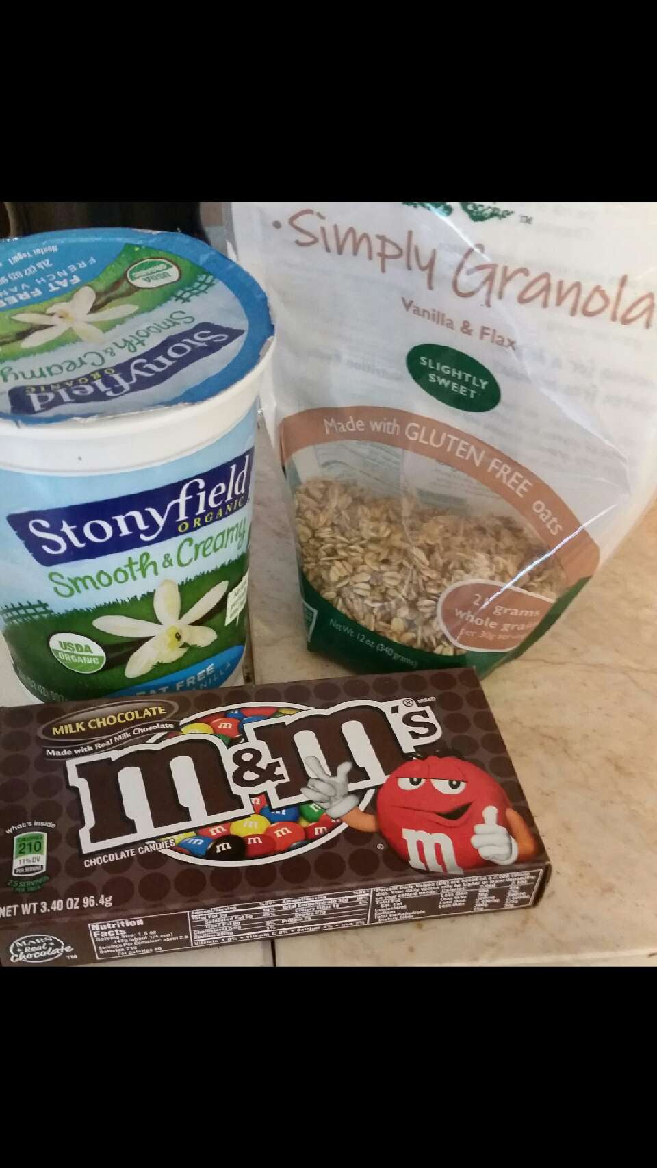 You can find these at your local Market Basket. (Believe it or not a little chocolate is actually good for you.)  I don't even like yogurt & I eat this every other morning & I love it!  Vanilla, fat free, Stony field yogurt Simply Granola, slightly sweet vanilla flax Regular (or peanut) m&m's