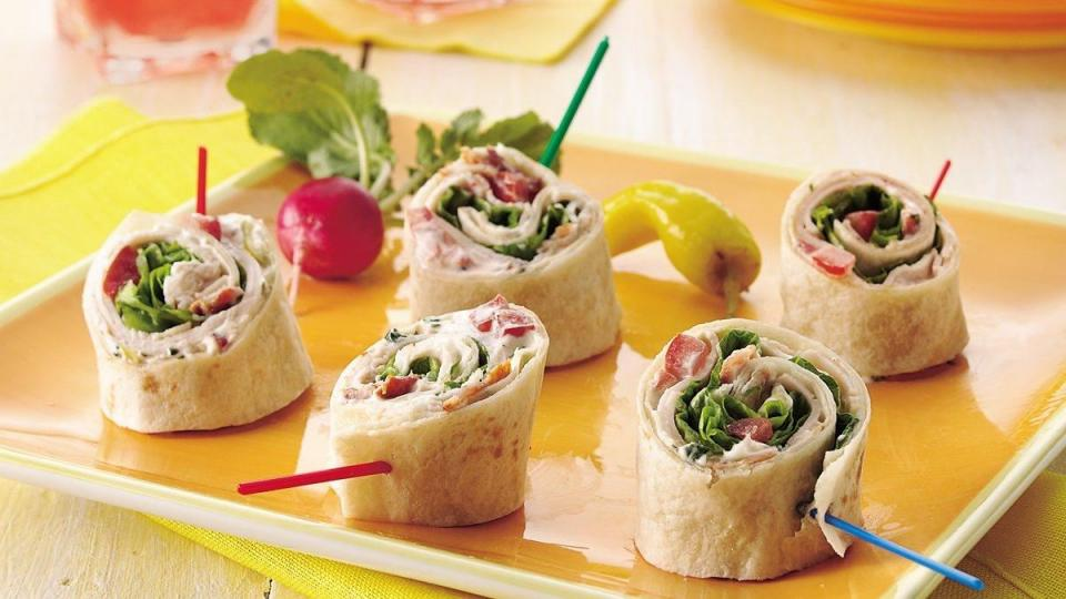 Pretty spirals filled with thin-sliced turkey from the deli, fresh greens, peppers, and creamy dressing, roll up fast for a quick lunch or appetizer