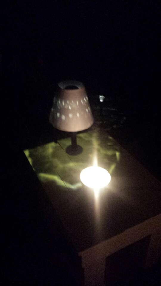 Finished with a lampshade modified to stay on the solar light and the base screwed down to the table.