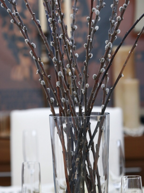 Simple, Yet Stunning A tall glass cylinder full of branches adds height to a tablescape. Since branches last longer than fresh flowers, you can use the display throughout the season.