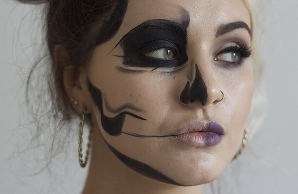Next, use a sharp, dark brown/purple eyeliner pencil like Illamasqua Honour Eye Colouring Pencil (£15) to create the outlines of the skeleton. Create a rough outline in this step as we'll be blending and neatening things up soon.