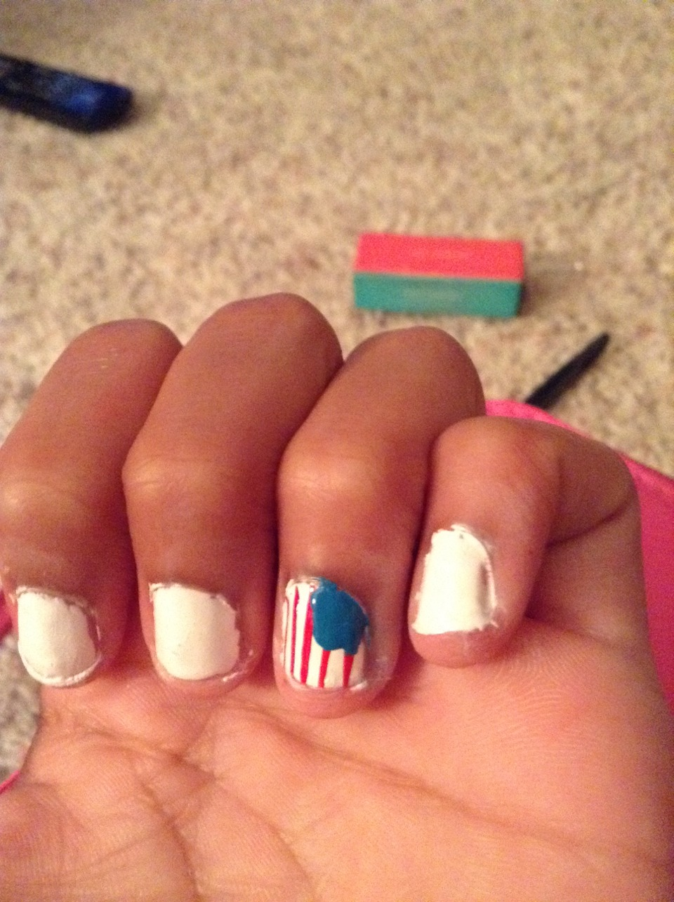 Next make a small square shape in the top corner of the nail. 🇺🇸