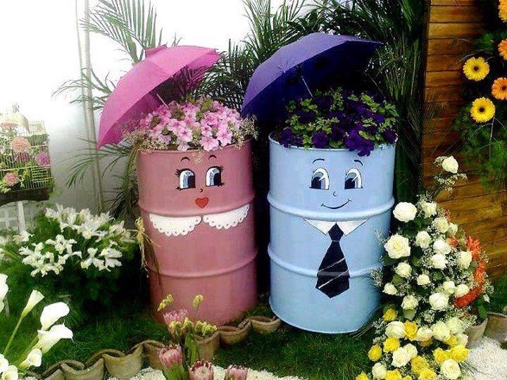 Have some old barrels laying around? Grab some paint and flowers and get to it!